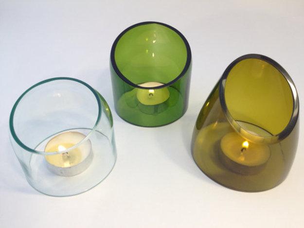 three glass holder candles