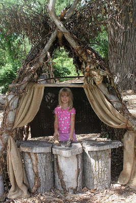 USE VINES AND TREE STUMPS TO MAKE A SMALL PUPPET THEATER