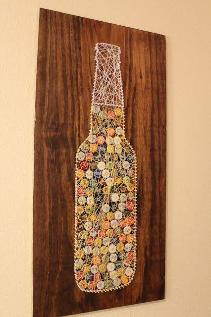 Strings and bottle caps will never look the same with this amazing wall art