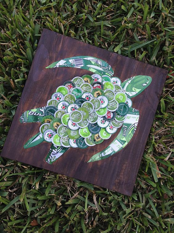 Take the sea and its beauty at home with this turtle bottle cap art