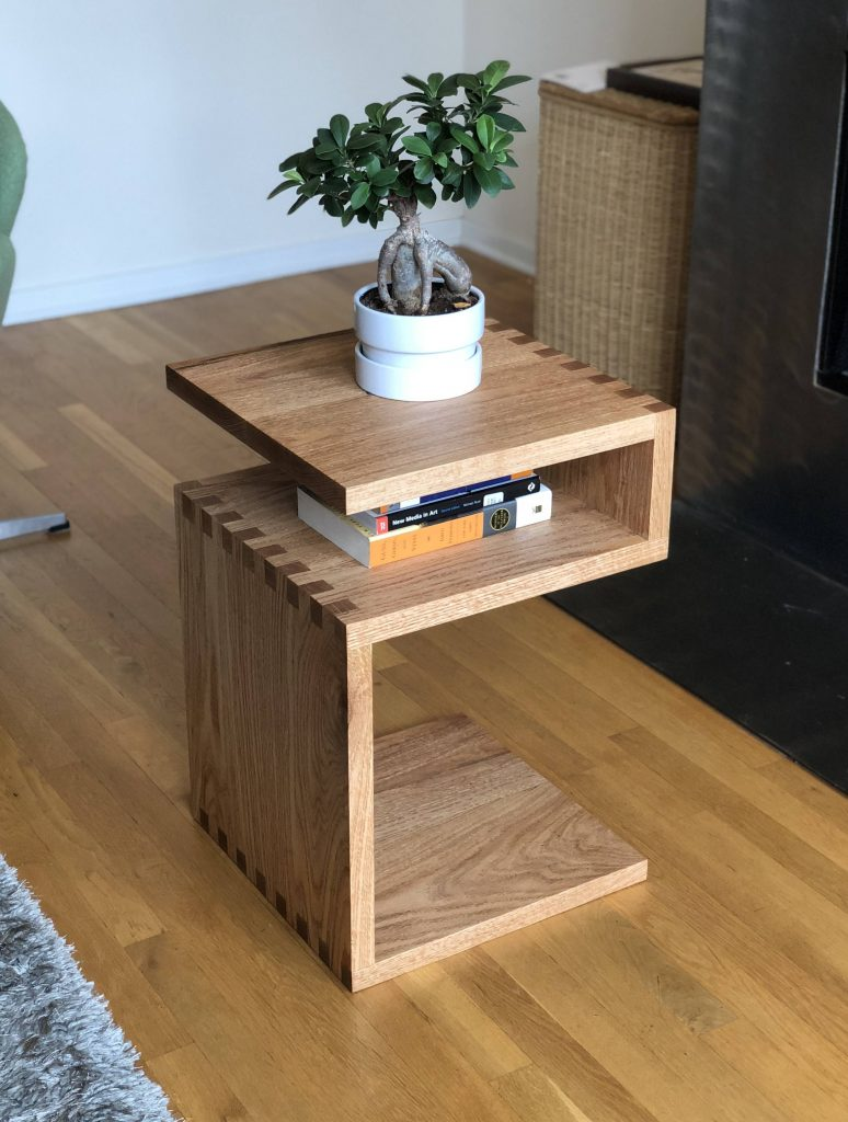 bonsai on table and books