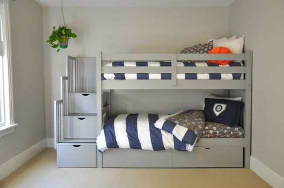 Bunk beds with storage areas on stairs and bottom drawers