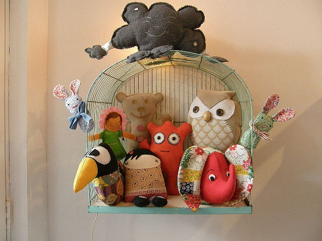 Recycle an old bird cage and store small colorful stuffed animals