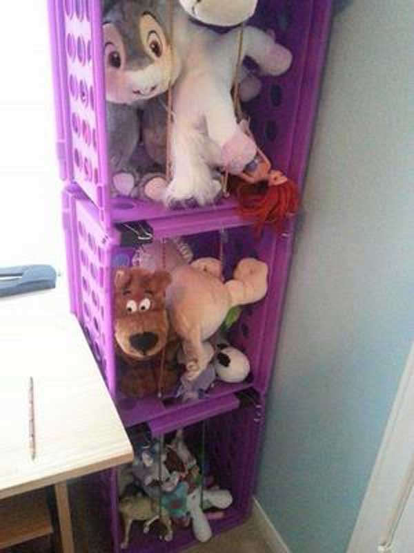 Stack up plastic crates to create a stuffed animal storage ensemble