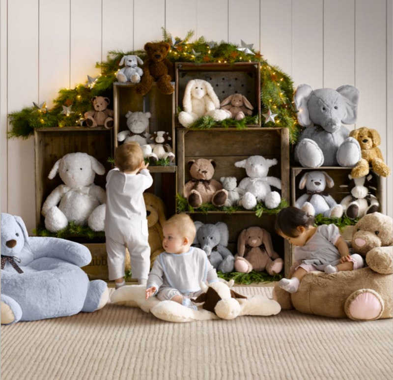 Use wooden crates to form a stuffed animal storage unit