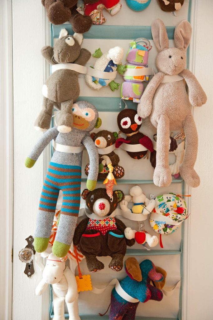 Hang a toy organizer on the door