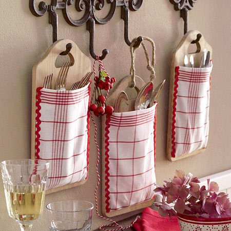 silverware pockets on wooden boards used as storage