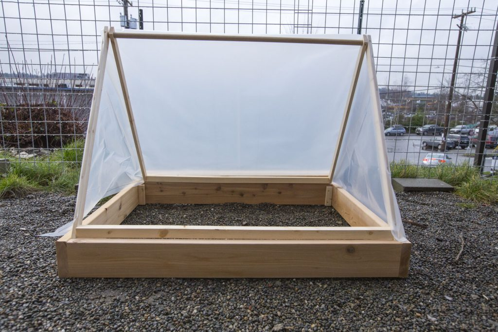 wooden and plastic wrap tent greenhouse
