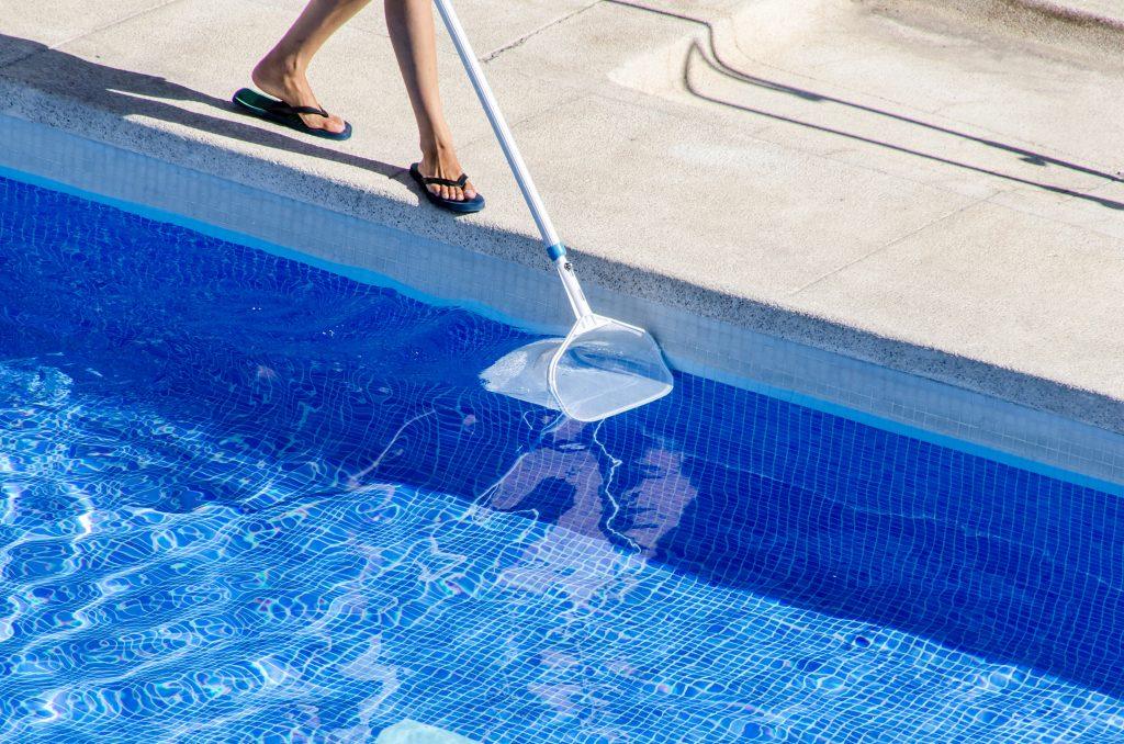 man in flip flop - robotic pool cleaner